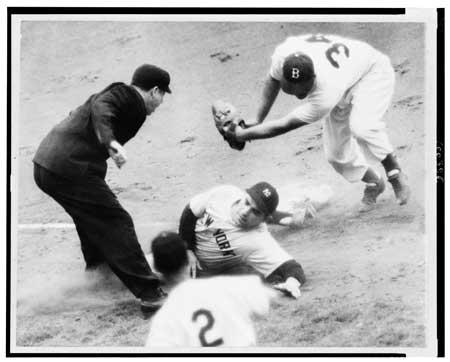Umpire Art Passarella calls Yogi Berra safe