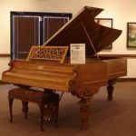 Boone's specially-made oak Chickering piano