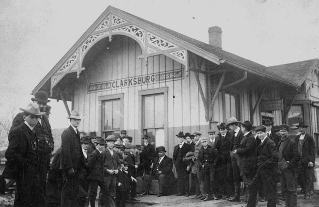 Boone at train station with crowd