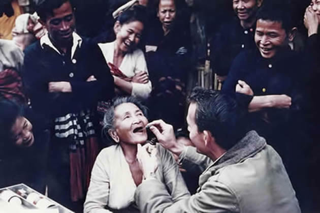 Dr. Dooley treats a Laotian woman