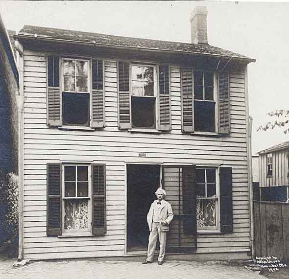 Twain in front of his boyhood home