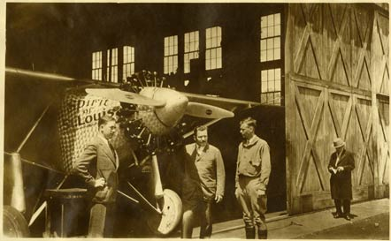 Lindbergh stands by his plane