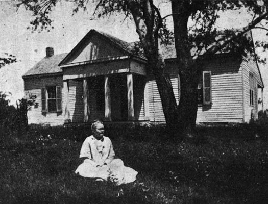 Nation in front of her childhood home
