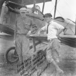 Lindbergh and his friend 'Bud' Gurney in front of a Curtiss Jenny
