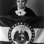 Marie Watkins Oliver with flag