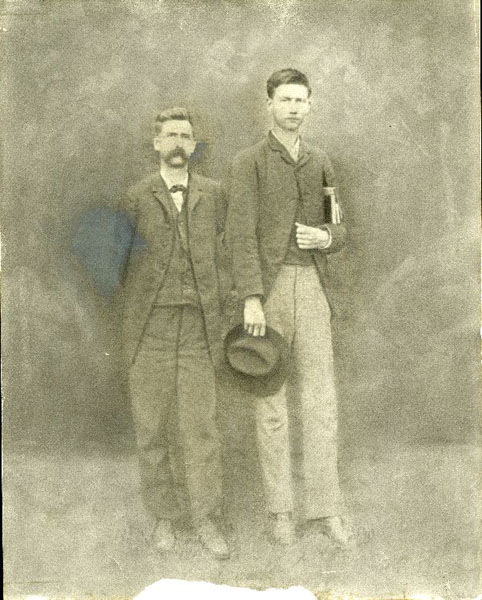 Curtis Marbut (right) standing with unidentified individual.