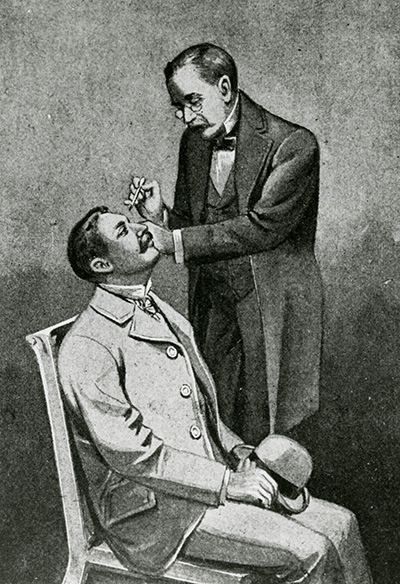 doctor checking the eyes of his patient