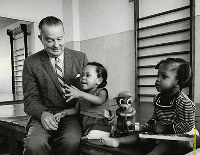 Dr. Rusk with child patients