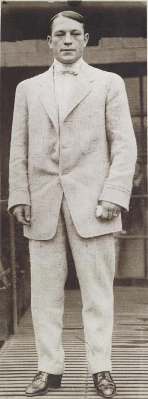 Ketchel in a suit and tie