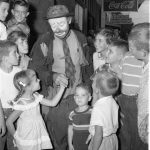 Emmett Kelly greets local children