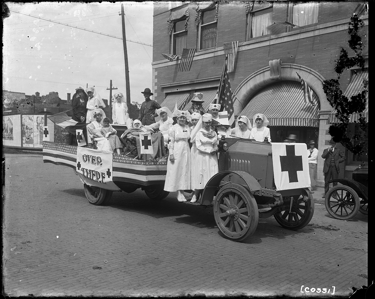 A float with Red Cross nurses in a World War I-era parade in Missouri, circa 1917
