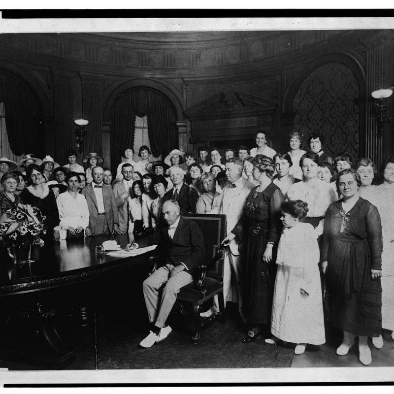 Governor Frederick Dozier Gardner signing the resolution ratifying the amendment to the U S Constitution granting universal franchise to women, 1919