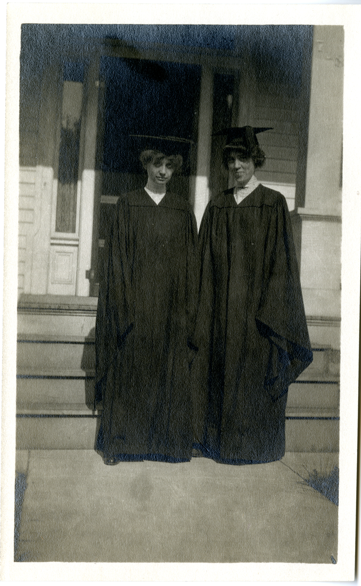 Sara with friend in cap and gown